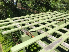 The Arbor Bench lattice top rotting away.