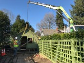 Holding our breath as the shed is lifted off the old pad