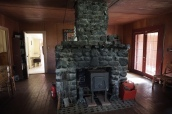 The hand built fireplace made with rocks carried up from the beach