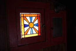 A custom made stained glass adorns the bathroom