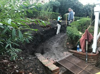The guys from Riverdale Landscape Construction hard at work hand excavating the pathway